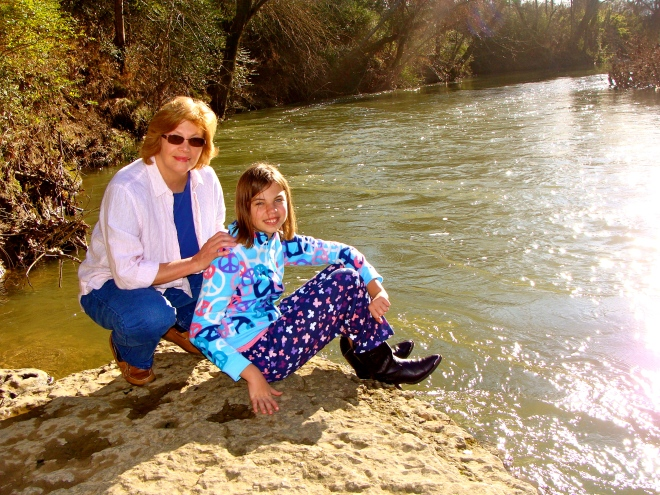 My aunt and daughter, Christmas morning 2011. Warm enough to walk to the river in our PJs.